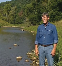 Eric Boehm standing on the shores of Brush Creek